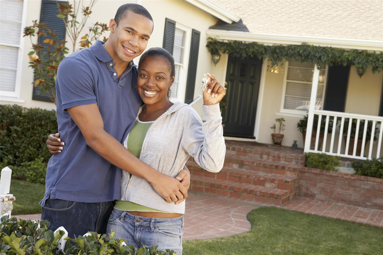 Couple in front of new house - Houses for sale in Seattle, Washington
